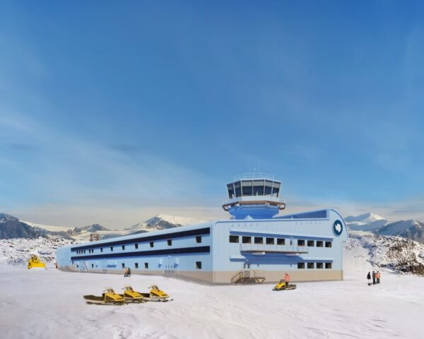 long blue building in snowy Antarctic landscape
