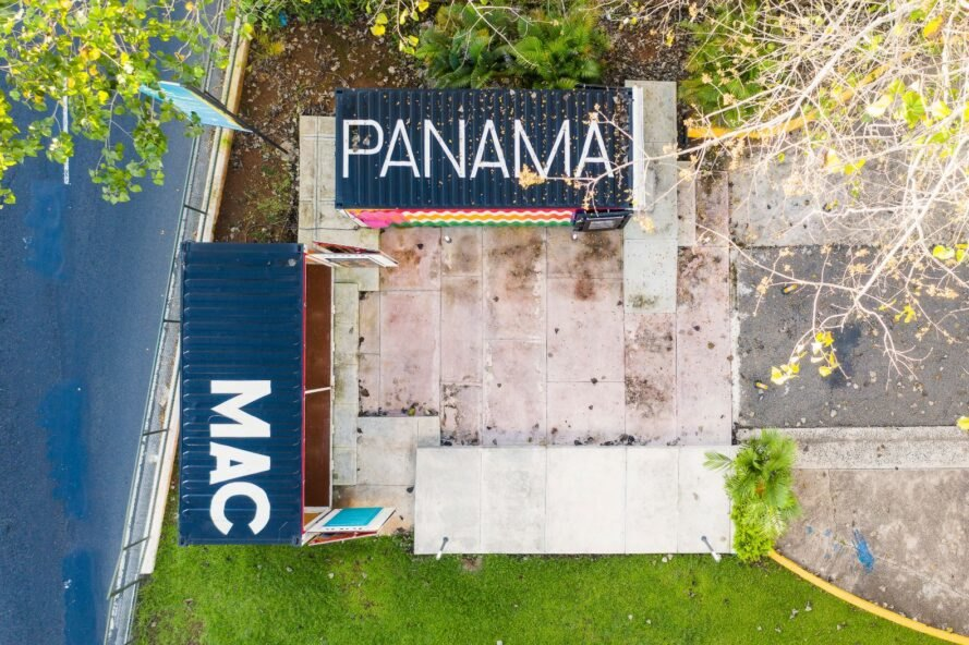 "aerial shot of two shipping containers with the words, ""Panama MAC"" on the roof"