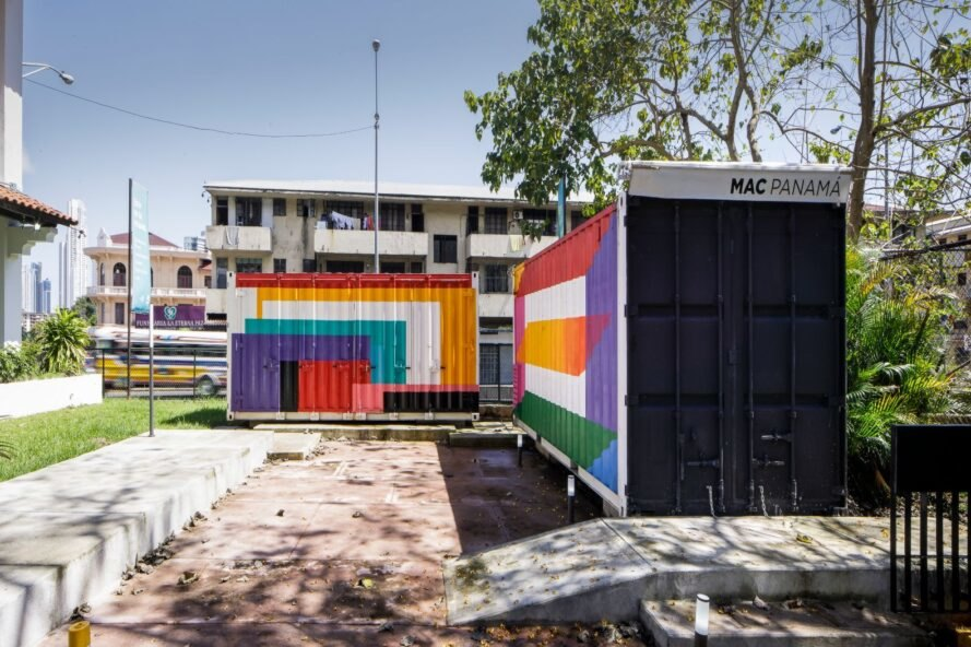 a shipping container building with multicolored exterior