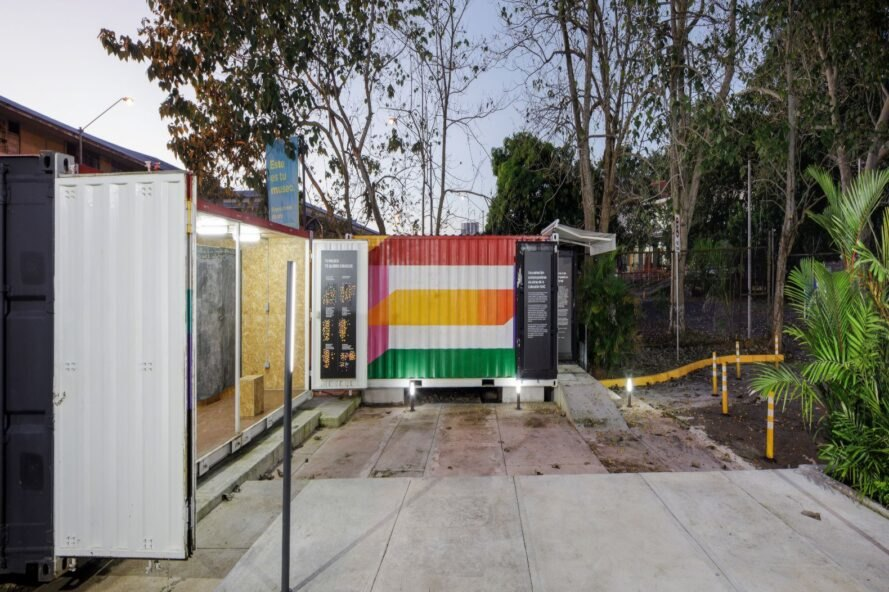 a shipping container with red, orange, and green stripes