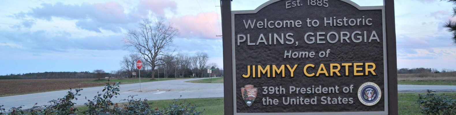 "brown sign that reads, ""Welcome to Plains, Georgia, home of Jimmy Carter, 39th President of the United States"""