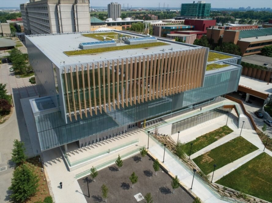 aerial view of glass building with green roofs