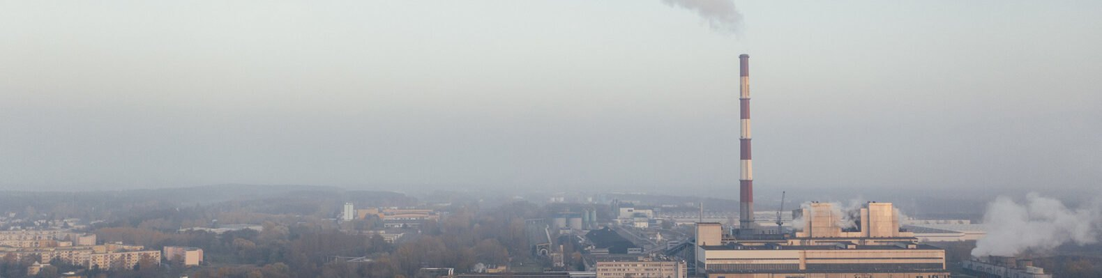 pollution from a factory creating smog over a city