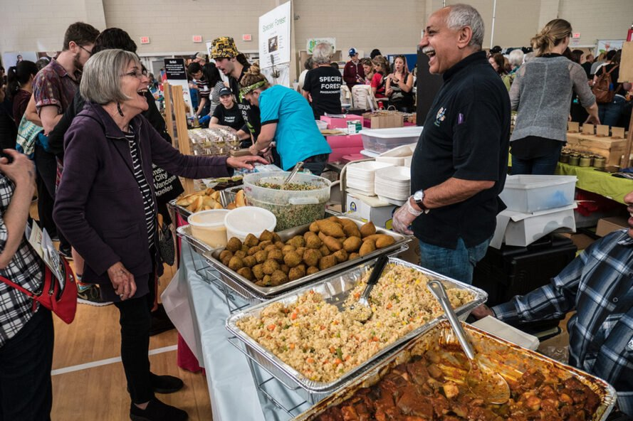 people talking while serving buffet-style vegan food