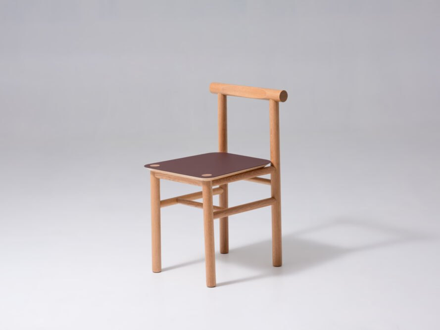 oak wood chair with a red seat