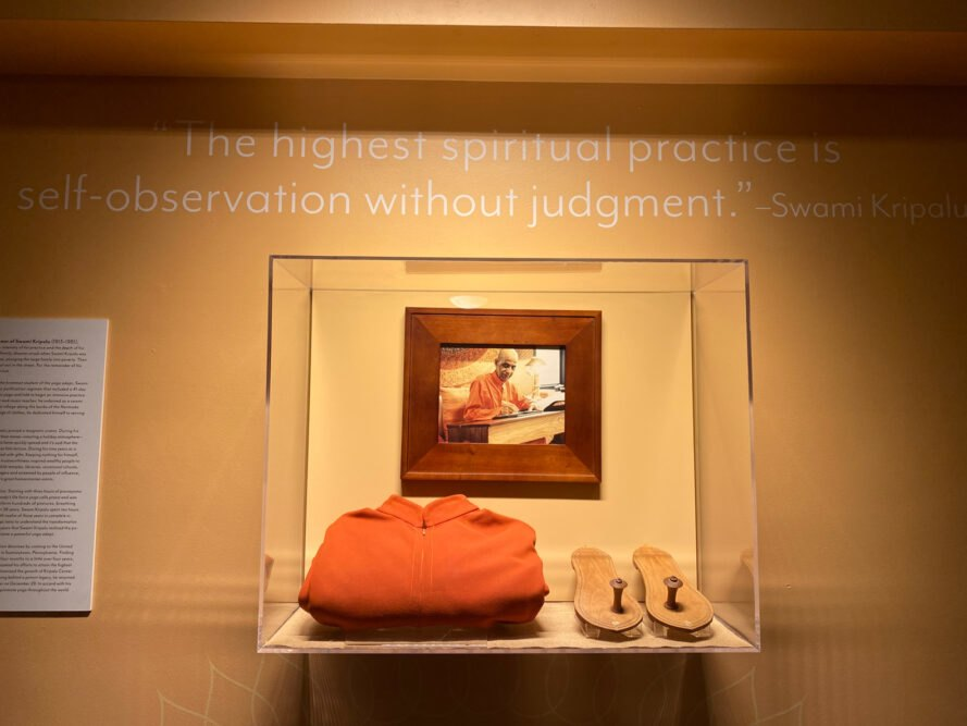 glass showcase box with clothing and shoes of Swami Kripalu