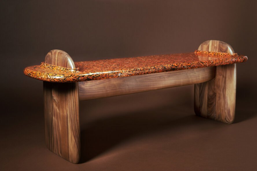 angled view of wood bench on brown background