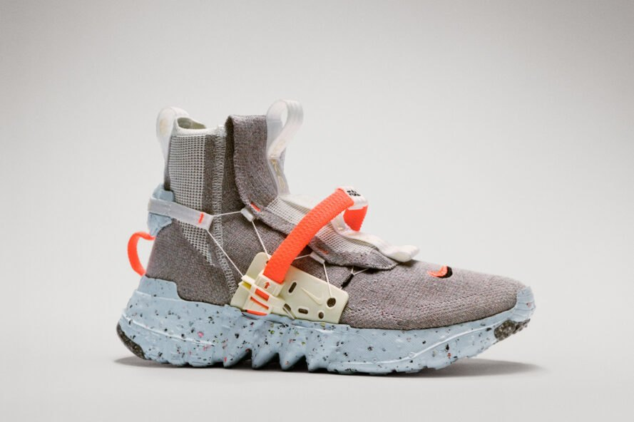 futuristic gray sneaker with orange straps