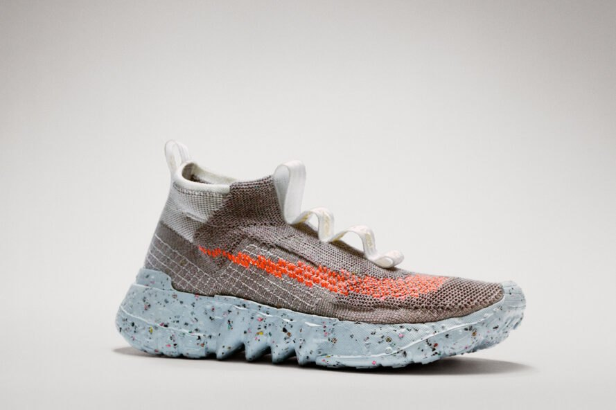 gray laceless sneaker with orange stripe