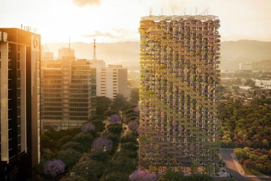 sun setting on green-infused tower