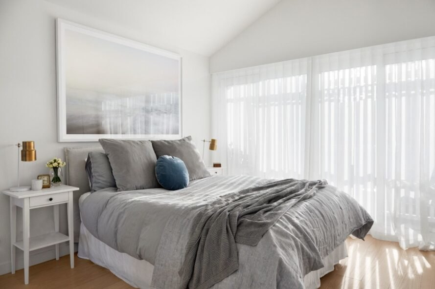 large bed with gray and white linens