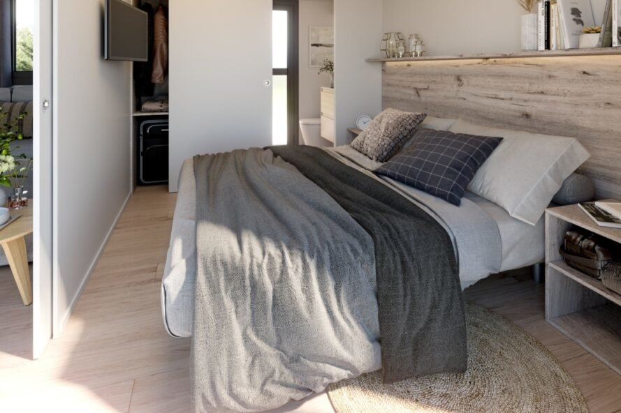 master bedroom with large bed covered in grey bedding
