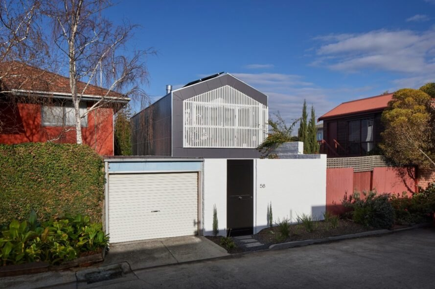 home design with pitched roof and silver and white exterior