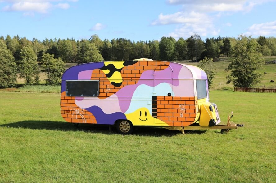 a campervan with multi-colored exterior