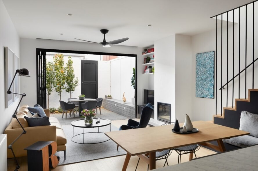 a living space that opens up to open-air patio