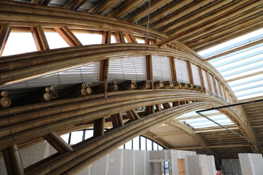 close-up of slightly curved bamboo rods in a pavilion