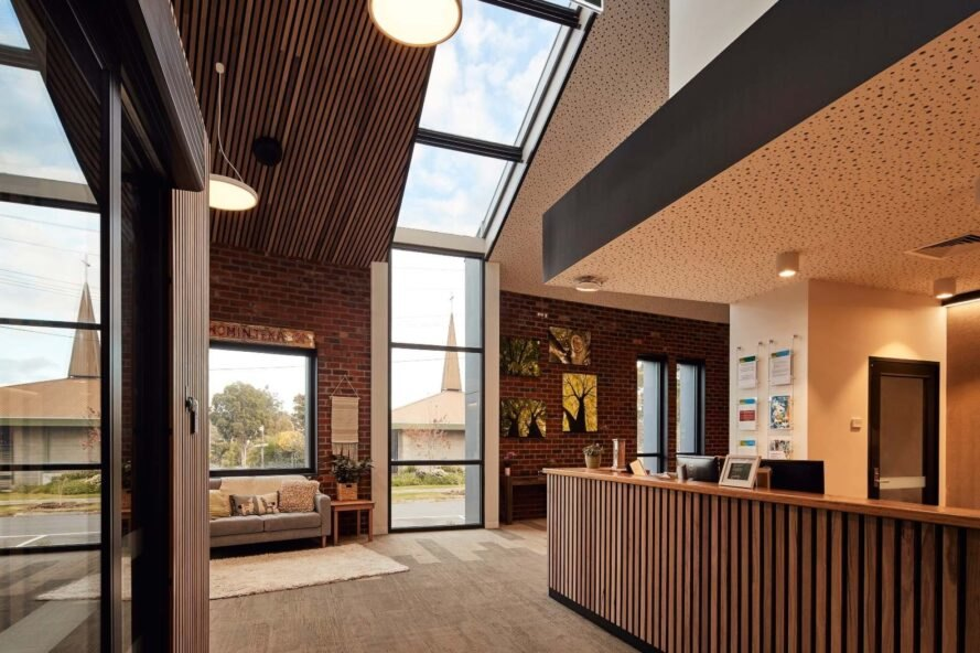 interior space with narrow vertical glass wall
