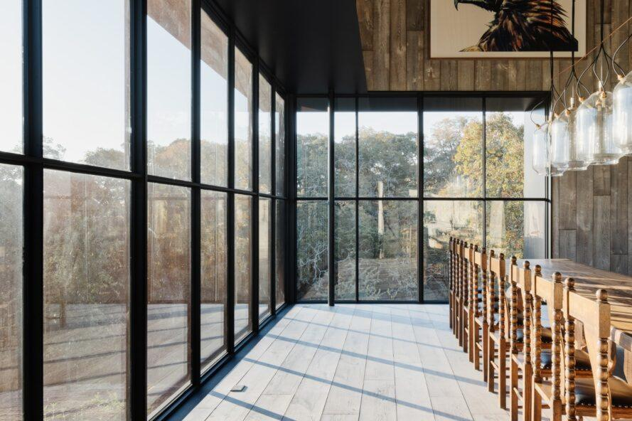 all-glass enclosure inside barn home