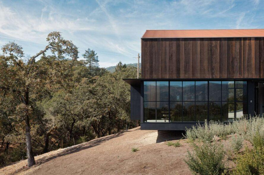home with glass-enclosed ground floor