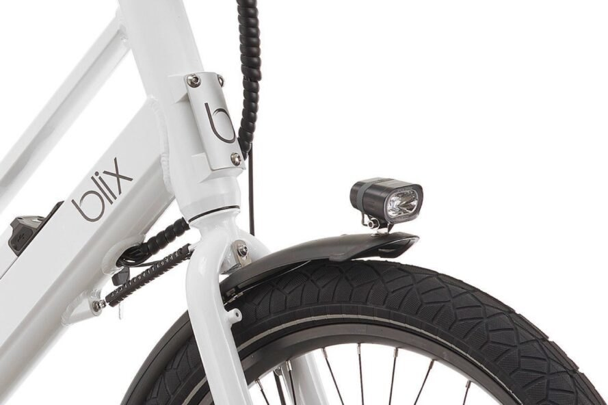 closeup of a tire on a white electric bike