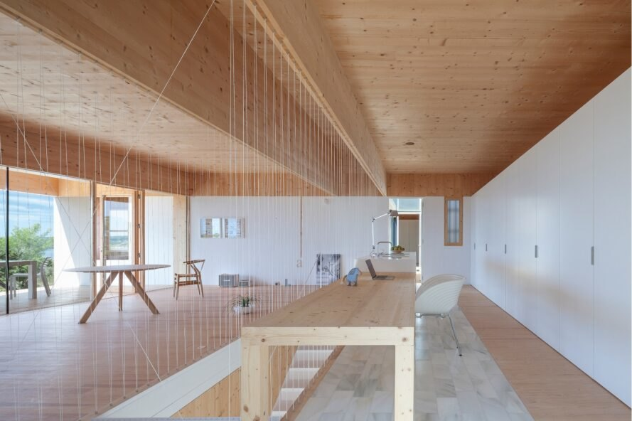 modern interior space with wooden ceiling and flooring