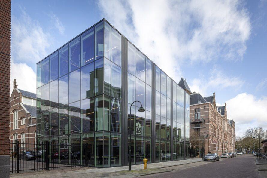 large cubic building with glass walls