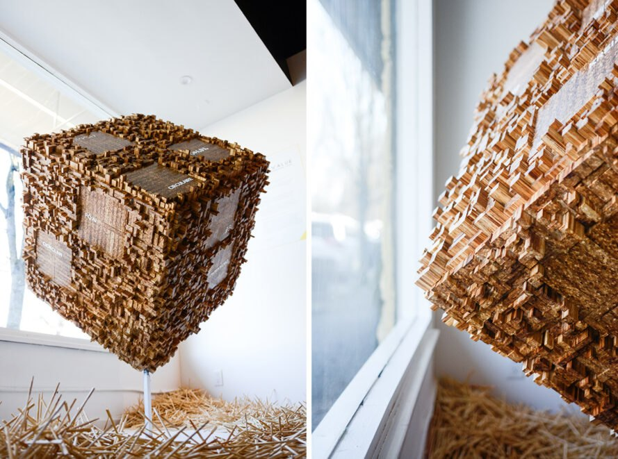 large artistic cube sculpture made of chopsticks