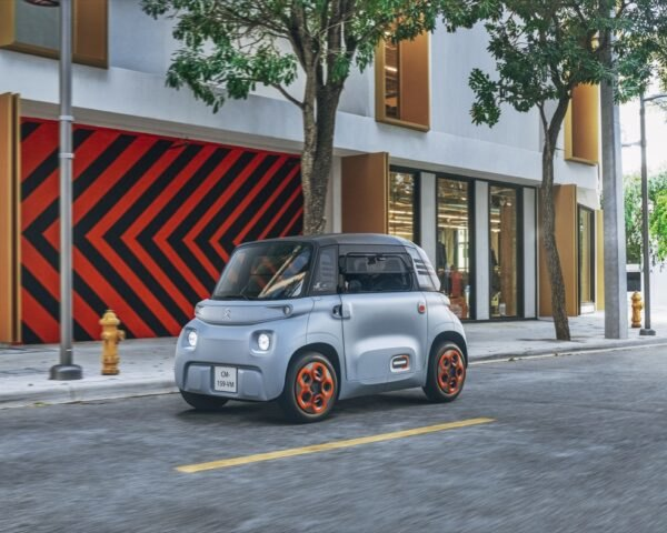 gray electric car on a city street