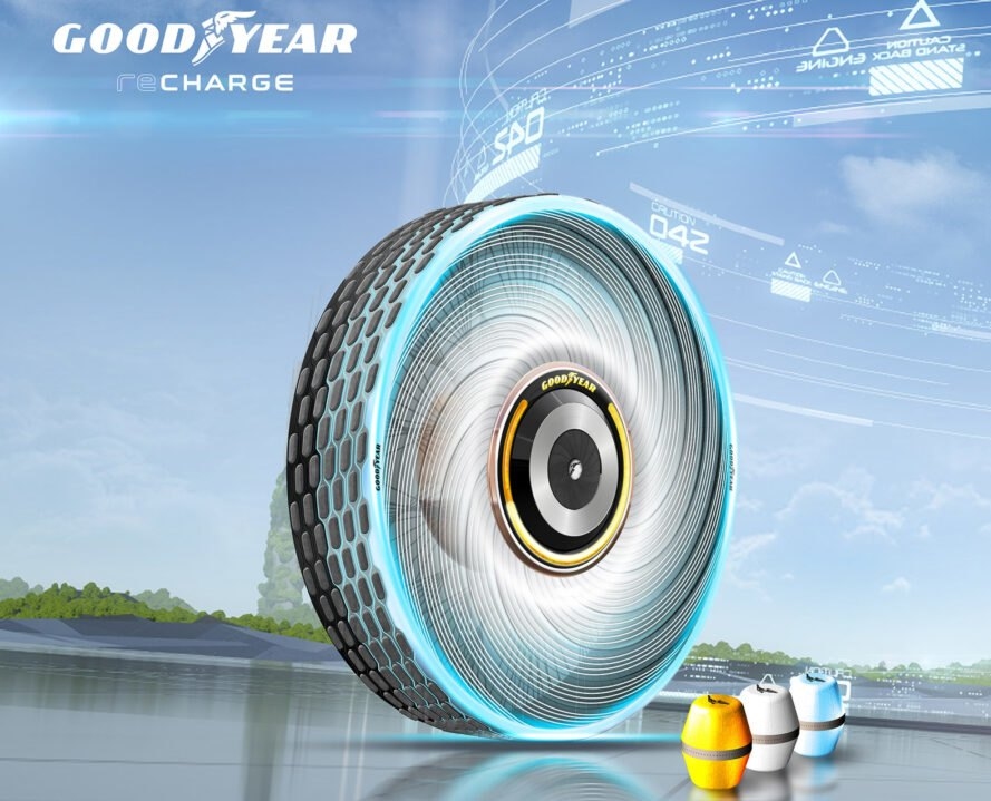 a futuristic tire against a blue background, with three pods next to it in the colors yellow, white and blue. the Goodyear logo is featured on the top lefthand side