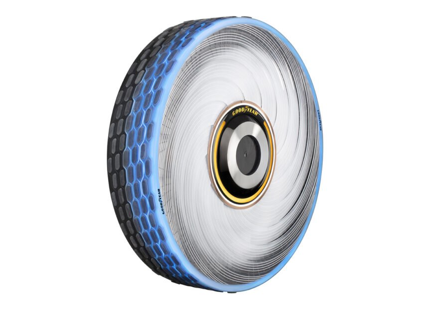 angled view of a futuristic looking tire with exterior blue detail and interior yellow detail