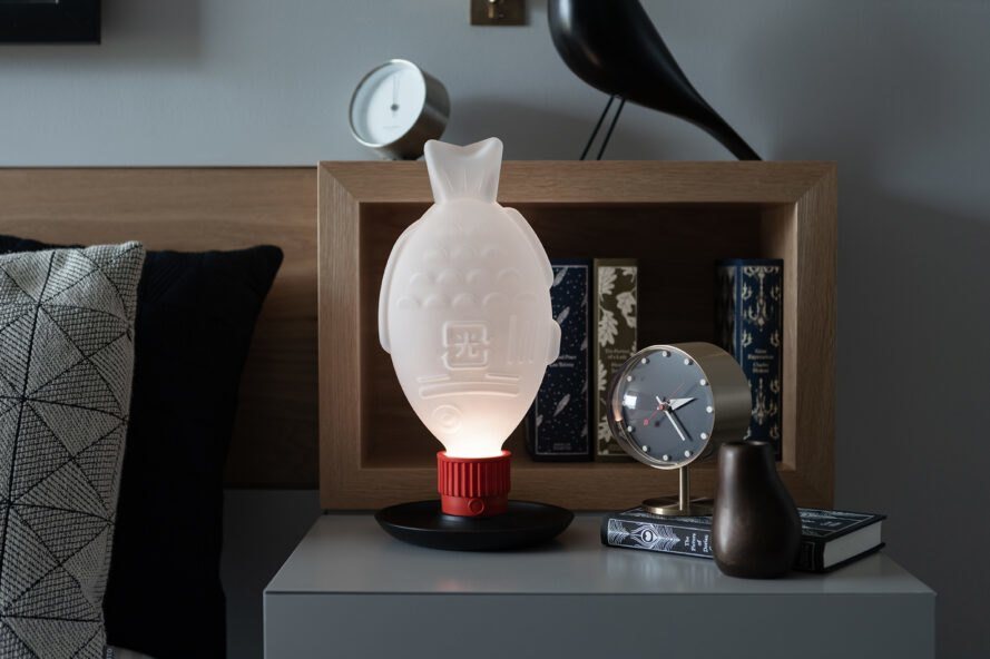 fish-shaped lamp on a nightstand