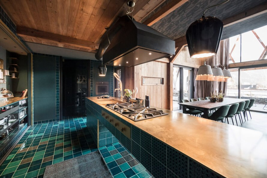 kitchen with blue tiles and wood countertops