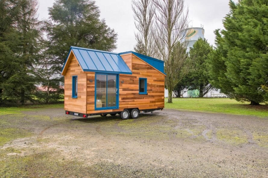 tiny wooden home on wheels with pitched roof