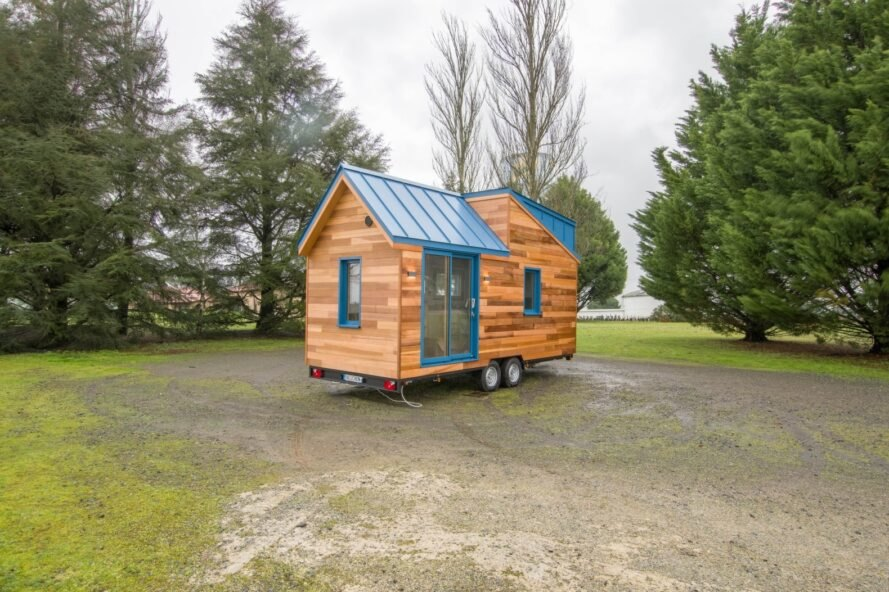 tiny home clad in honey-hued wood panels