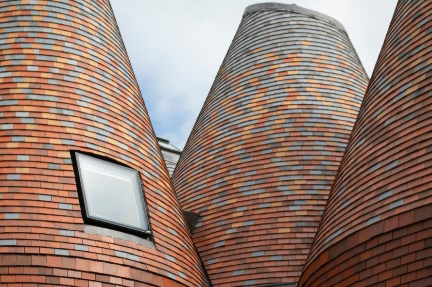 conical structures clad in red brick