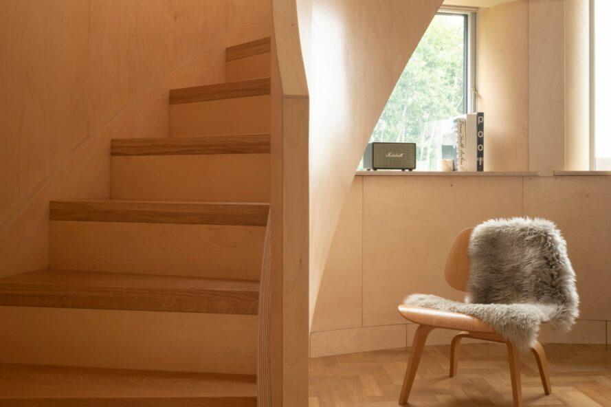 small nook with chair beside timber staircase