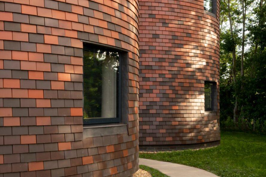circular structure clad in red brick
