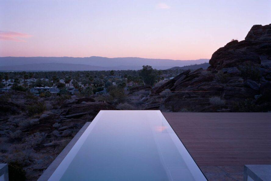 infinity pool looking out over the desert at dusk