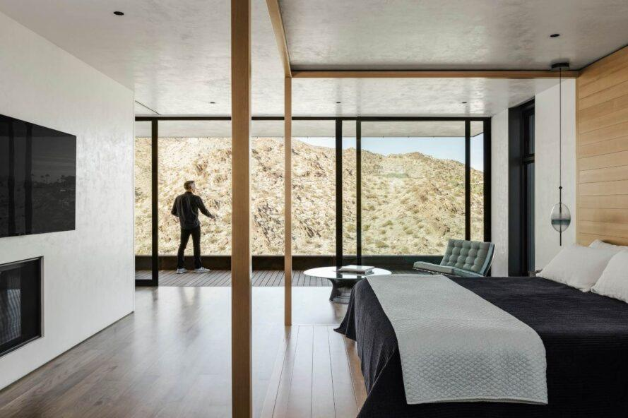 bedroom with all glass wall