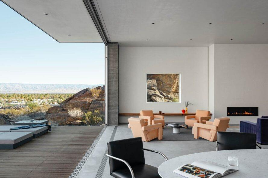 living area connected to an outdoor deck via large opening