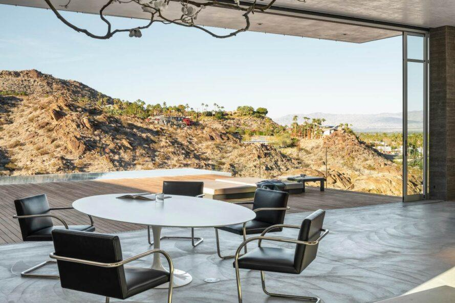 round dining table with seating looking out over hilly landscape