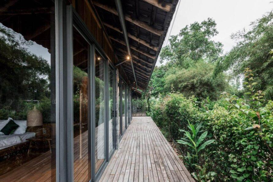 bungalow with glass wall and narrow wood balcony