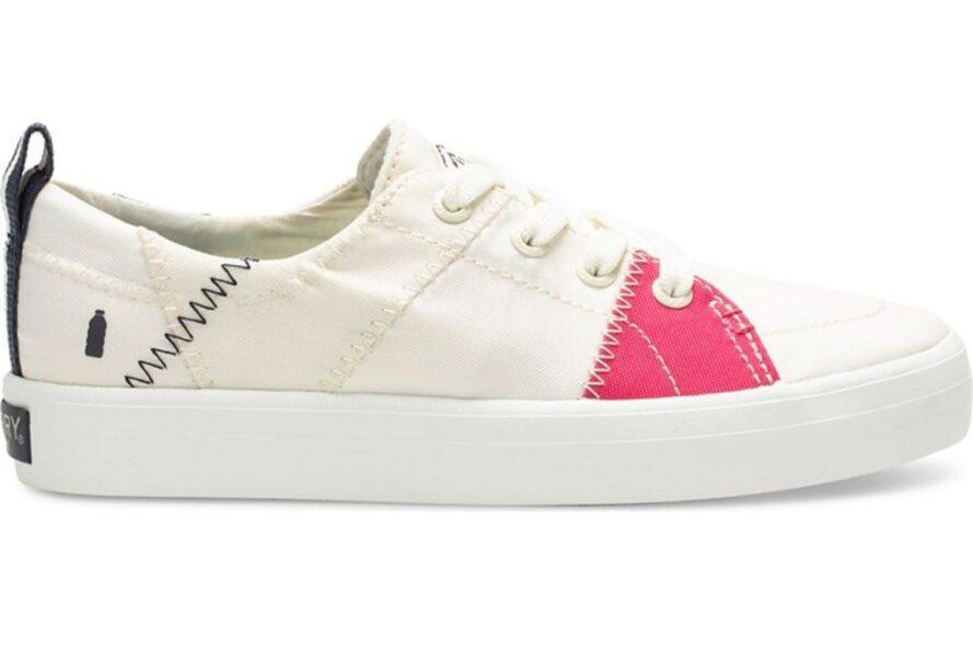 white tennis shoe with pink accents