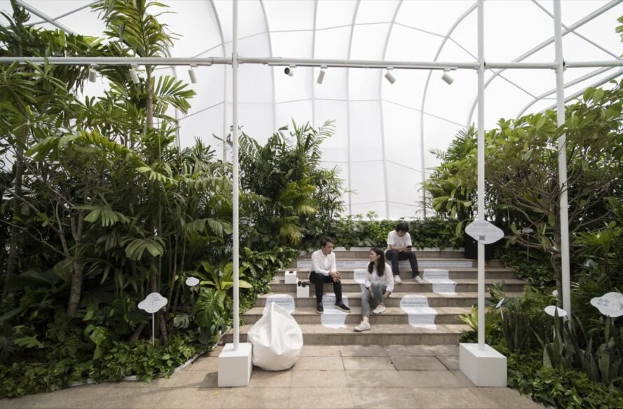 white pavilion filled with plants