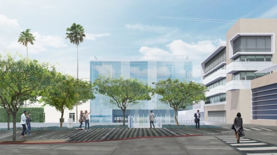 rendering of parking lot leading to a rectangular glass building