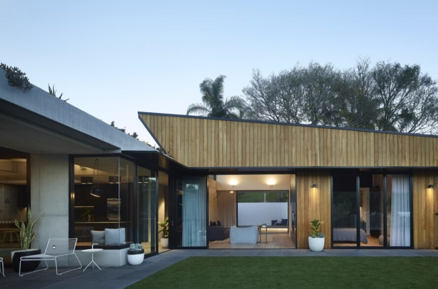 home extension with black and light wood cladding