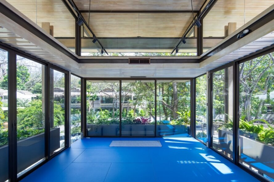 large interior room with all glass walls and blue floors