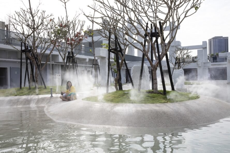 person and baby sitting near misty pool