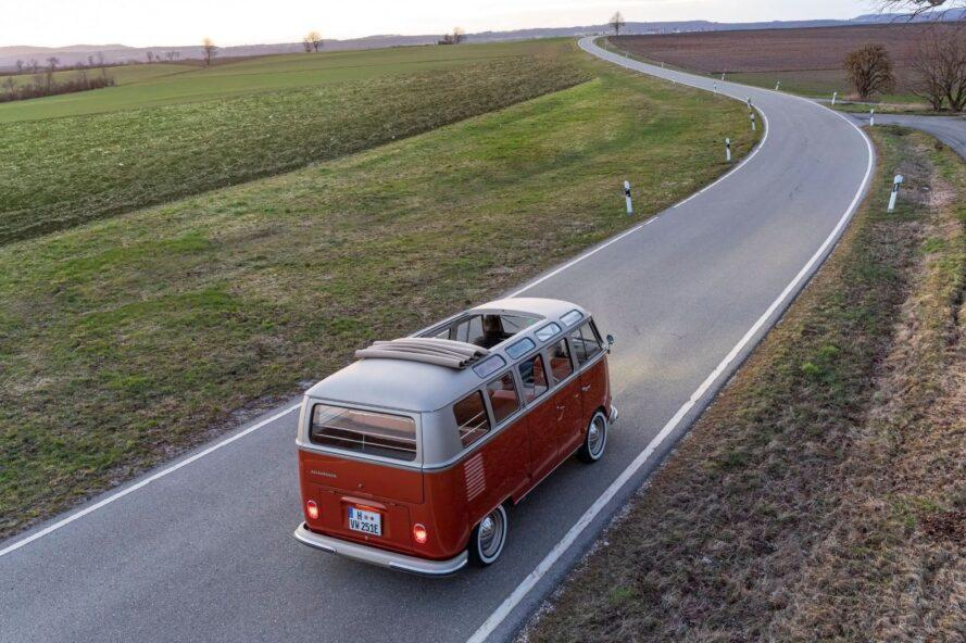 aerial shot of VW van driving on a winding road