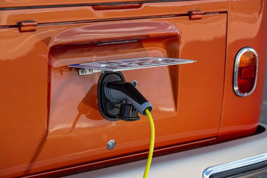 electric plug charging an orange van